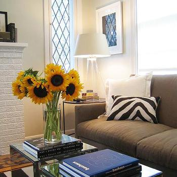 Elizabeth Sullivan Design - living rooms - light gray, walls, white, brick, fireplace, gray, sofa, zebra, pillow, mirrored, accent tables, clear, tapered, clear, glass, lamps, mirrored cubes, mirrored cube tables,
