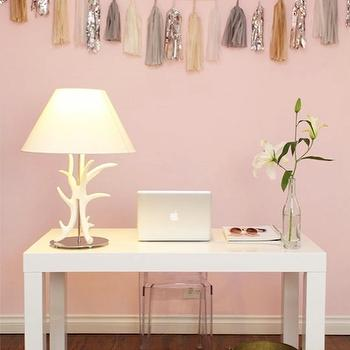 Cupcakes and Cashmere - dens/libraries/offices - pink, walls, West Elm, Antlers lamp, pink walls, pink paint colors, West Elm Parsons Desk, Confetti Systems Garland, Kartell Ghost Chair,