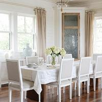 Herlong & Associates - dining rooms - vaulted, ceiling, linen, sheers, dining table, white, linen, tablecloth, gray, French, square, back, dining chairs, corner cabinet, dining room cabinet, built in cabinet, built in dining room cabinet, corner dining room cabinet,