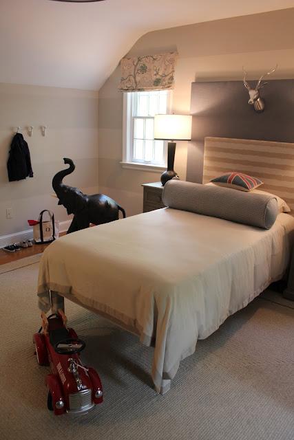 boy's rooms - tone-on-tone striped walls gray nightstand black lamp red firetruck tan striped headboard layered gray headboard gray bolster pillow