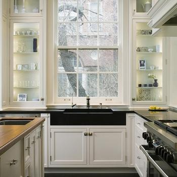 Robbins Architecture - kitchens - ivory, glass-front, kitchen cabinets, honed, black, granite, countertops, apron, sink, ivory, kitchen island, butcher block, countertops, sink in kitchen island, black sink, black kitchen sink,