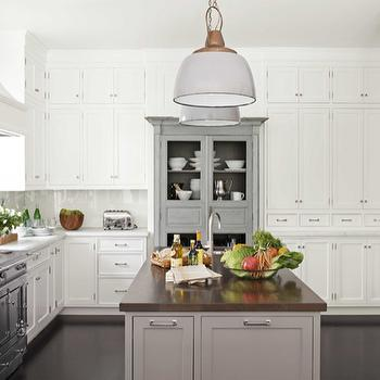 House Beautiful - kitchens - gray, kitchen island, walnut, butcher block, countertop, chicken wire, gray, antique, armoire, white, shaker, kitchen cabinets, marble, countertops, walnut butcher block, walnut butcher block countertops, Gaul Searson Vintage Ship Light, La Cornue Chateau 150 Range,