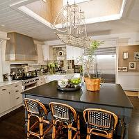 Andrea May Hunter Gatherer - kitchens - square, blue, kitchen island, honed, black, countertop, Crystal Ship Chandelier, white, kitchen cabinets, marble, countertops, groove, ceiling, beadboard, backsplash, ship chandelier, crystal ship chandelier,