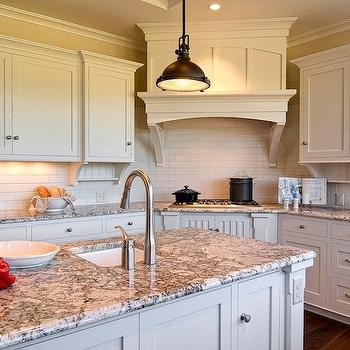 Farinelli Construction - kitchens - ivory, kitchen cabinets, kitchen island, granite, countertops, oil rubbed bronze, industrial pendants, sink in kitchen island, granite countertops, polar cream granite, polar cream countertops, polar cream granite countertops,