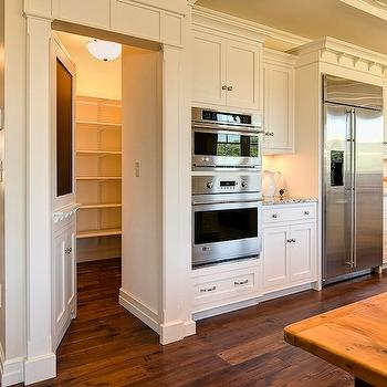 Farinelli Construction - kitchens - chalkboard, faux cabinet, hidden, pantry, ivory, kitchen cabinets, granite, countertops, hidden pantry, hidden pantry door,