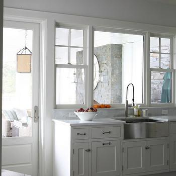 Foley & Cox - kitchens: pale, blue, walls, stainless steel, apron, sink, white, kitchen cabinets, marble, countertops, apron sink, stainless steel apron sink,