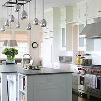 Foley &amp; Cox - kitchens - white, kitchen cabinets, marble, countertops, kitchen island, soapstone, countertop, sink in kitchen island, mercury glass, pendants,