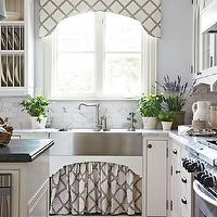 Traditional Home - kitchens - lilac, walls, stainless steel, apron, sink, ivory, kitchen cabinets, marble, countertops, ivory, kitchen island, black, honed, beveled, granite, countertop, kitchen valance, kitchen window valance, skirted sink, skirted kitchen sink, trellis valance, The Rug Market Out There Cane Rug,