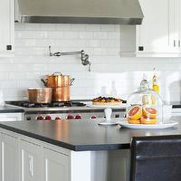 Traditional Home - kitchens - copper pots, creamy, white, shaker, kitchen cabinets, kitchen island, honed, black, granite, countertops, Ann Sacks, subway tiles, backsplash, glass, cloche, Rohl, pot filler,