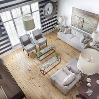 Ty Larkins Interiors - living rooms - gray, convex, mirrors, flanking, window, white, black, horizontal, stripe, accent wall, white, sofa, chairs, twin, tripod, floor lamps, gray, accent chairs, coffee stained, wood, media, cabinet, TV, stripe wall, striped wall, black and white striped wall, white and black striped wall,