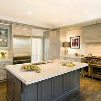 Cassia Design - kitchens - light gray, glass-front, kitchen cabinets, dark, gray, kitchen island, marble, countertops, sink in kitchen island, porcelain, tiles, floor, gray island, gray kitchen island, charcoal gray kitchen island, charcoal gray islands, gray kitchen cabinets,