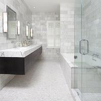 Ty Larkins Interiors - bathrooms - seamless glass shower, marble, subway tiles, shower surround, backsplash, espresso stained, modern, floating, double bathroom vanity, chunky, marble, countertop, wall-mount, faucet kits, inset, medicine cabinets, flanked, modern, sconces, small, marble, tiles, floor, soaking, tub,