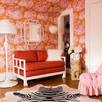 Angie Hranowski - girl's rooms: pink, orange, wallpaper, white, octagon, mirror, white, floor lamp, white, sofa, red, cushions, zebra, cowhide, rug, pink, tufted, chair, wicker, elephant, table, wicker table, elephant table, wicker elephant table,
