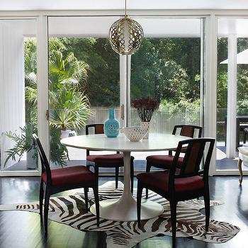 Angie Hranowski - dining rooms - black, dining chairs, fuchsia, cushions, zebra, cowhide, rug, brass, pendant, sand, grasscloth, wallpaper, mirrored, console, table, teal, blue, Hollywood Regency, tufted, ottomans, saarinen table, saarinen dining table, Saarinen Dining Table,