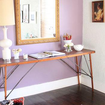 Design Sponge - entrances/foyers - lilac, accent wall, industrial, console, table, white, lamp, gold, mirror, purple, peacock, feather, rug, runner, purple wall, purple accent wall,