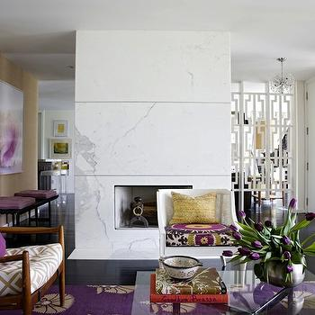 Angie Hranowski - living rooms - white, cane, chair, mid-century modern, chairs, glass-top, coffee table, marble, slab, fireplace, sand, grasscloth, wallpaper, white, fretwork, room divider, double sided fireplace, double sided marble fireplace, David Hicks La Fiorentina - Ivory/Camel, Madeline Weinrib Atelier Grape Otto Rug, Donghia Suzani in Pink Passion,