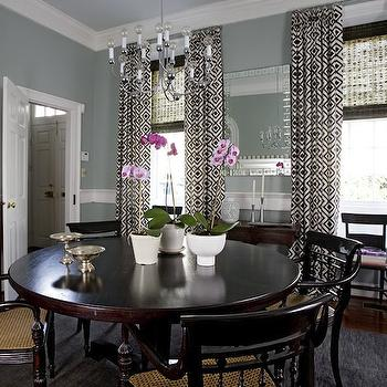 Angie Hranowski - dining rooms - drapes, layered, bamboo, roman shades, blue, gray, walls, round, pedestal, dining table, black, cane, dining chairs, antique, buffet, white, glass, lamp, black, shade, La Fiorentina curtains, David Hicks La Fiorentina,