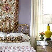 Angie Hranowski - bedrooms - lilac, purple, walls, tapestry, wall art, wicker, bed, mirrored, nightstand, yellow, lamp, mirror nightstands, mirrored nightstands, mirrored bedside tables,