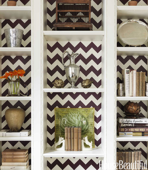 House Beautiful - living rooms - white, built-ins, back of shelves, white, brown, chevron, herringbone, pattern, hand painted, built-in cabinets, living room built-ins, white built-ins, white built-in cabinets, built-in bookcase, living room bookcase, lined built ins, lined built-in cabinets,