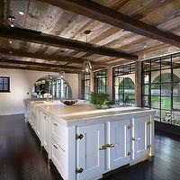 Forest Studio - kitchens - rustic, wood, planks, box beams, ceiling, floor to ceiling, windows, glass, pendants, white, kitchen cabinets, kitchen island, marble, countertops, subway tiles, backsplash, rustic beams, rustic wood beams wood beams, exposed beams, exposed beam ceiling, kitchen ceiling beams,