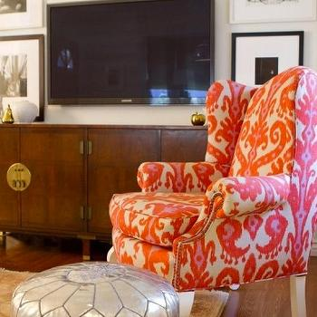 Turquoise LA - living rooms - coral, ikat, fabric, vintage, wingback, chair, Chinese, media, cabinet, brass, medallions, TV, art gallery, silver, metallic, pouf, pink ikat chair, ikat chair,