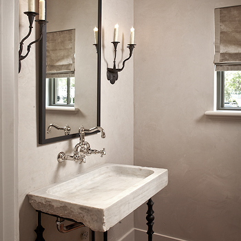 The Owen Group - bathrooms - gray, textured, walls, iron, hanging, mirror, flanked, iron, sconces, stone, vessel, iron, sink, terra cotta, tiles, chevron, herringbone, floot, gray, velvet, roman shade, stone washstand, stone vanity, stone bathroom vanity, stone sink, brick floor, brick herringbone floor,