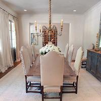 The Owen Group - dining rooms - wall, gray, French doors, ivory, linen, drapes, ivory, pom pom, tassels, fringe, linen, camelback, dining chairs, French, brass, tacks, rectangular, dining table, Joyce Horn, gray, vintage, buffet, arch, mirror,
