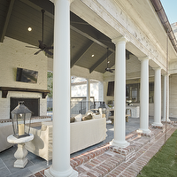 The Owen Group - decks/patios - covered, Greek, columns, white, brick, fireplace, TV, white, slipcover, sofa, chairs, covered deck, covered patio,