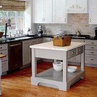 Cote de Texas - kitchens - creamy, white, shaker, top, kitchen cabinets, gray, base, shaker, kitchen cabinets, black, granite, countertops, travertine, subway tiles, backsplash, gray, kitchen island, Calacatta Oro, marble, countertop, polished nickel, bridge, faucet, gray kitchen cabinets, gray kitchens, gray cabinets, calcutta ora marble, calcutta ora marble countertops, rockport gray,