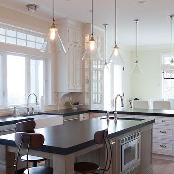 Jenny Baines - kitchens - white, kitchen cabinets, gray, kitchen island, black, countertops, farmhouse, sink, vintage stools, vintage bar stools, architects stool, vintage architects stool, Arteriors Carlton Pendant,