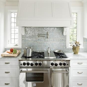 Jenny Baines - kitchens - miniature, blue, glass, tiles, backsplash, white, shaker, kitchen cabinets, white, carrara, marble, countertops, pot filler, sand walls, Ann Sacks Tile,