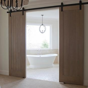 Jenny Baines - bathrooms - sliding, barn doors, freestanding, tub, marble, mosaic, tiles, floor, barn doors, interior barn doors, bathroom barn doors, Arteriors Rittenhouse Chandelier,