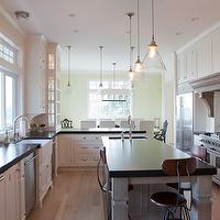 Jenny Baines - kitchens - white, kitchen cabinets, gray, kitchen island, small, sink in kitchen island, black, countertops, pot filler, miniature, travertine, subway tiles, backsplash, carlton pendant, Arteriors Carlton Pendant,