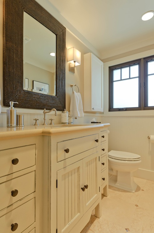 Regan Baker Design - bathrooms - Sherwin Williams - Accessible Beige - Sherwin Williams Alabaster, travertine, tiles, floor, extra-wide, single, bathroom vanity, travertine, countertop, chocolate, brown, woven, mirror, beadboard, walls, travertine, tiles, floor,