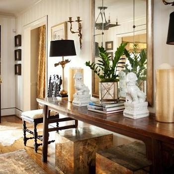 CBB Interiors - entrances/foyers - glossy, black, door, cowhide, rug, Chinese, wood, antique, altar, table, white, foo dogs, antique, brass, lamps, black, shades, gold, cube, ottomans, tables, foo dogs, white foo dogs,