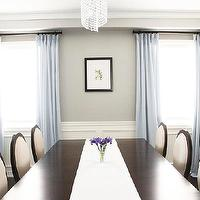http://www.amdolcevita.com - dining rooms - Dining Room, double pedestal mahogany ding table, criss cross dining chairs, Benjamin Moore Revere Pewter, Tribeca sideboard, dining room, crystal chandelier, blue grey silk drapes, mirrored chests, dining room wainscoting moulding, revere pewter, revere pewter,