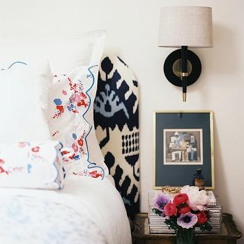 Lonny Magazine - bedrooms - headboard, vintage, metal, table, ikat headboard, Quadrille Kazak Ikat in Blue, Robert Abbey Jonathan Adler Ventana Wall Sconce - Black & Brass, D Porthault Paris Bedding,