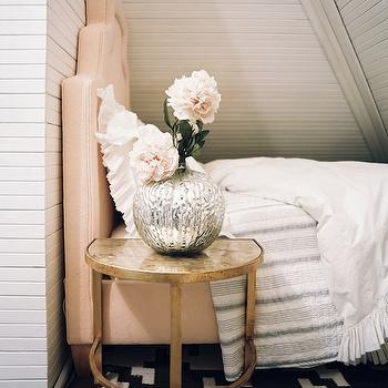 Lonny Magazine - bedrooms - attic, bedroom, pink, velvet, bed, black, white, geometric, rug, white, ruffled, shams, duvet, brass, table, nightstand, pink headboard, velvet headboard, pink velvet headboard,