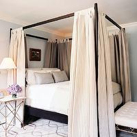 Lonny Magazine - bedrooms - blue, walls, ebony, canopy, bed, ticking, panels, silver, gray, silk, pillows, metallic, faux bamboo, bench, white, tufted, cushion, silver, gray, geometric, pattern, rug, marble, top, brass, directoire, accordion, table, brass, swing-arm, sconces,