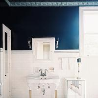 Lonny Magazine - bathrooms - navy blue, walls Greek key, pattern, moldings, subway tiles, backsplash, blue, Greek key inset tiles, white, porcelain, 2 leg, washstand, mirrored, cabinet, marble, hex, tiles, floor, blue Greek key, border, tiles, greek key trim,
