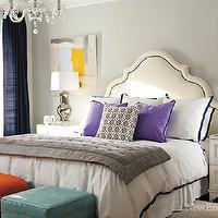 New England Home - bedrooms: blue, drapes, gray, walls, white, headboard, nailhead trim, purple, pillows, gray, quilt, teal, blue, Moroccan, ottomans, nailhead trim, mercury glass, lamps, teal ottoman, teal leather ottoman,