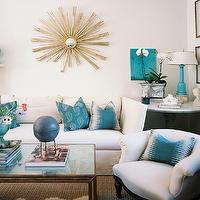 Lonny Magazine - living rooms - vintage, gold, sunburst, mirror, white, sofa, teal, blue, pillows, marble, top, pedestal, table, turquoise, blue, lamp, turquoise lamp, turquoise table lamp, turquoise blue lamp,