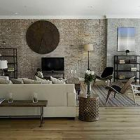 Marie Burgos Design - living rooms - sectional sofa, iron clock, shell chair, industrial bookshelf, jute rug, wooden bench, natural oak floors, brick wall, acrylic photography art, francis augustine, brick wall, brick accent wall, brick living room, brick living room ideas, brick fireplace wall, brick fireplace,