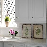 Loi Thai - kitchens - framed, botanical, prints, white, shaker, kitchen cabinets, marble, slab, countertops, backsplash, farmhouse, sink, leaded, windows, peonies,