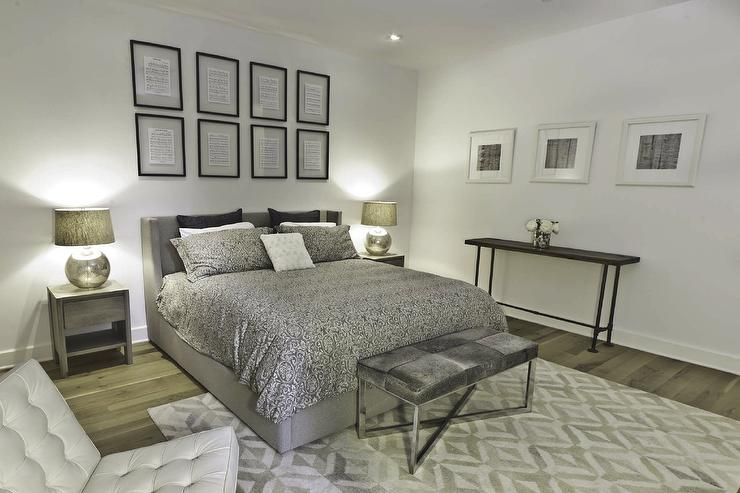 Marie Burgos Design - bedrooms - Benjamin Moore - Decorators White - mercury lamps, nightstand table, wool rug, cowhide bench, upholstered bed, grey bedding, white leather chair, wood bench, natural oak floors, silver bedding, silver duvet, silver shams,