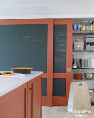 Elle Decor - kitchens - Farrow and Ball - Blazer - orange, kitchen island, marble, top, orange, chalkboard, sliding doors, pantry, chalkboard doors, pantry doors, sliding doors, sliding pantry doors, chalkboard sliding doors,