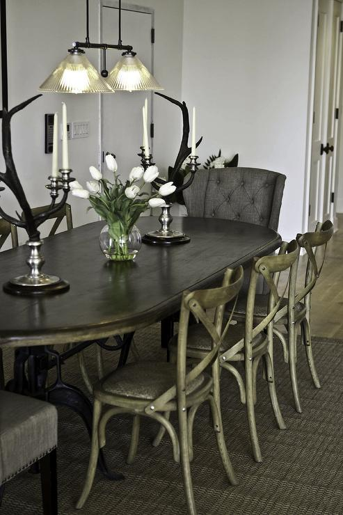 Marie Burgos Design - dining rooms - Benjamin Moore - Decorators White - oval dining table, upholstered armchairs, cane dining chairs, candelabra, pendant lighting, jute rug, gray wingback chair, gray tufted chair, gray wingback tufted chair, gray wingback dining chairs,