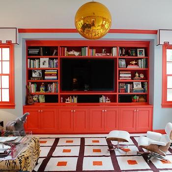 Peppermint Bliss - media rooms - blue, walls, glossy, red, mouldings, red, built-ins, cabinet, media center, TV, gold, globe, pendant, white, cornice boxes, red, trim, kids, Eames, Lounge, Ottoman, built in cabinets, red cabinets, red built ins, red built in cabinets, Jonathan Adler Peter Rug,