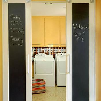 BHG - laundry/mud rooms - yellow, walls, chalkboard, sliding, barn, doors, yellow, lacquer, cabinets, white, washer, dryer, yellow cabinets, yellow laundry room cabinets, yellow lacquer cabinets,
