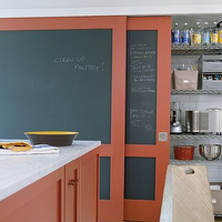 Elle Decor - kitchens - orange, kitchen island, marble, top, orange, chalkboard, sliding doors, pantry,  Fun orange kitchen with orange kitchen